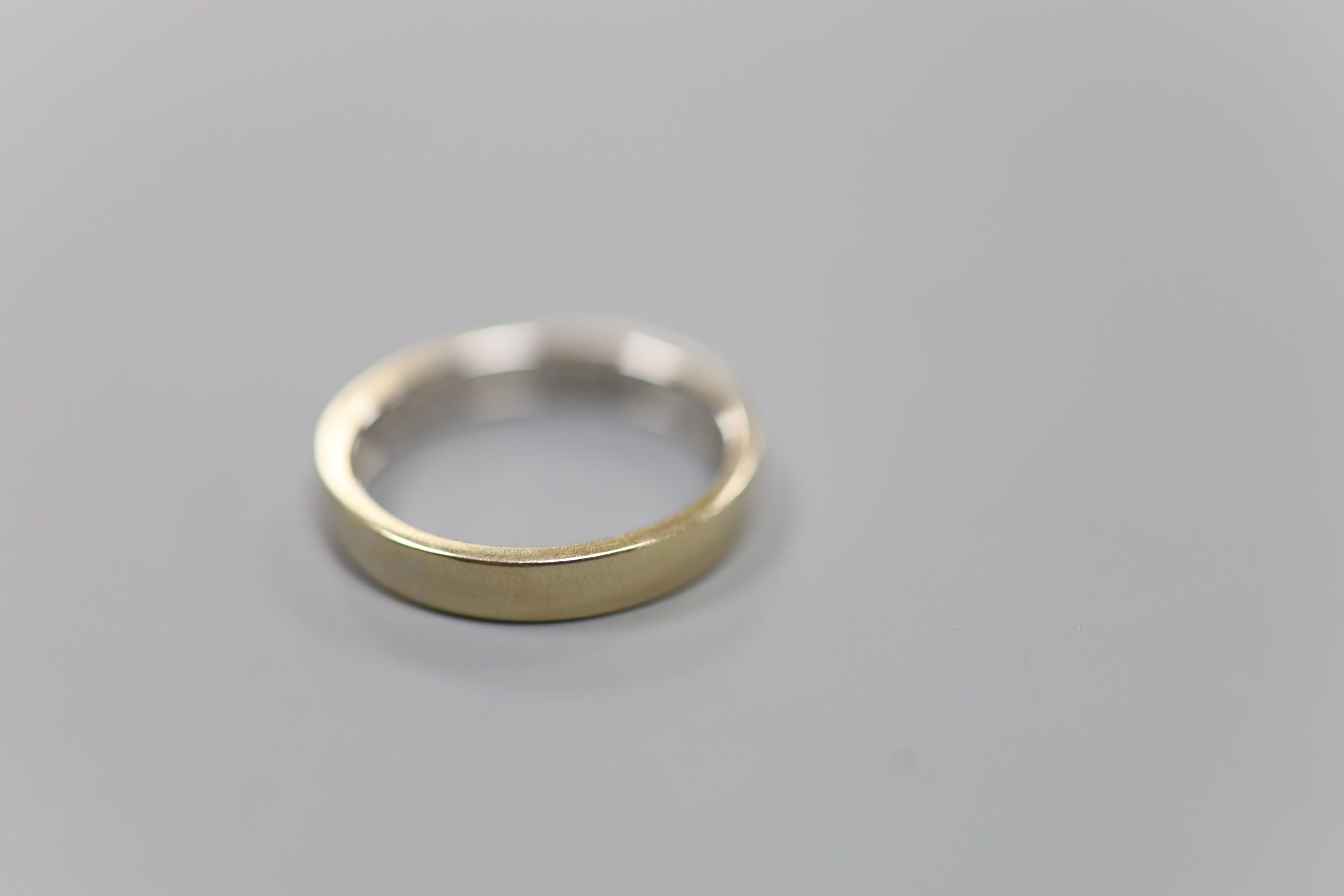 A modern 18ct white gold (worn) and nine stone channel set diamond half eternity ring, size P,gross - Image 4 of 4