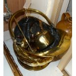 A Victorian helmet shaped coal scuttle and other metalware