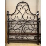 A wrought iron single bed frame, width 117cm
