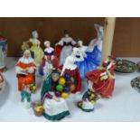 Ten Royal Doulton figurines, including 'Sara', 'The Judge', 'The Old Balloon Seller', 'Elaine' and