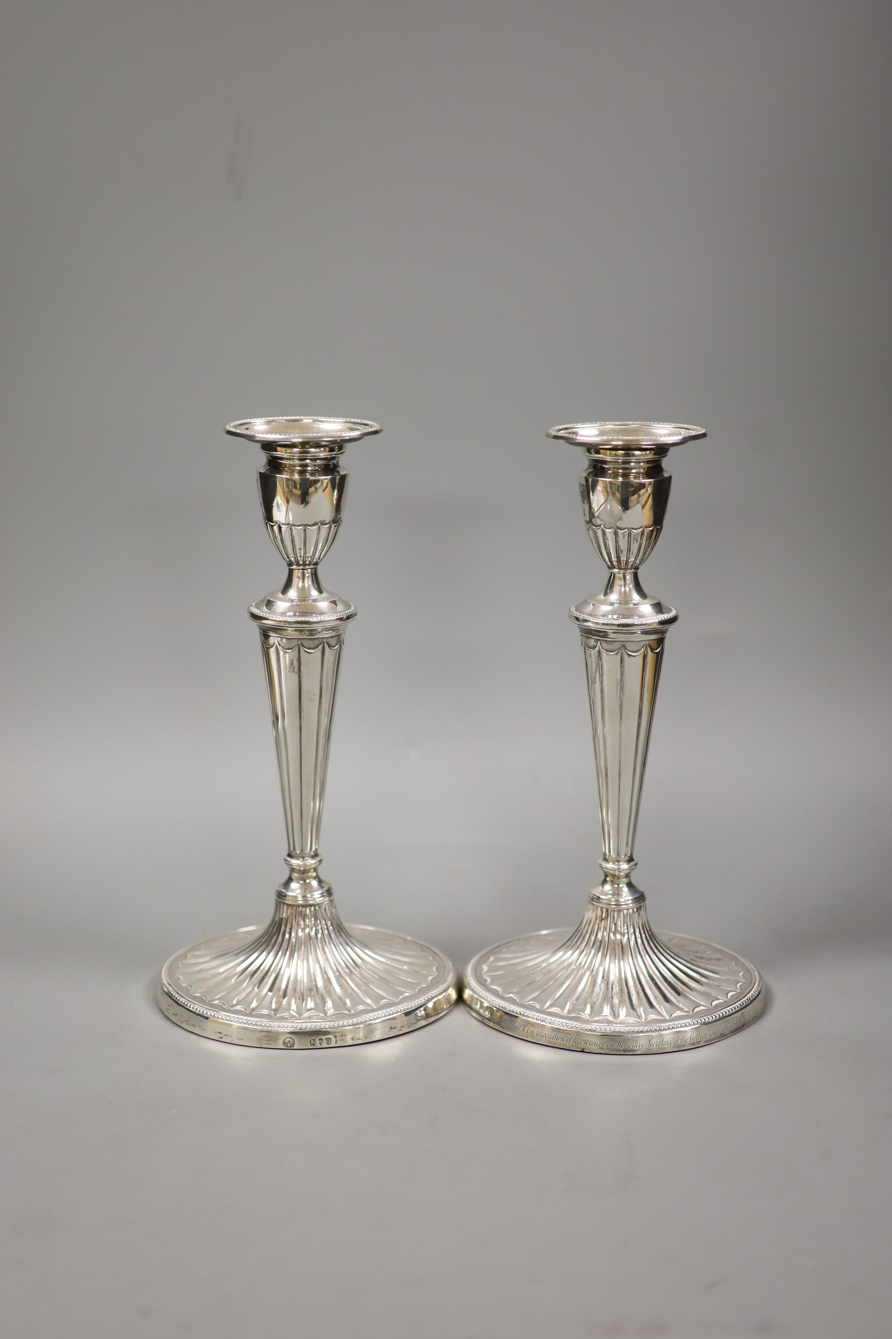 A pair of late Victorian silver oval candlesticks, with engraved inscription, Charles Stuart Harris