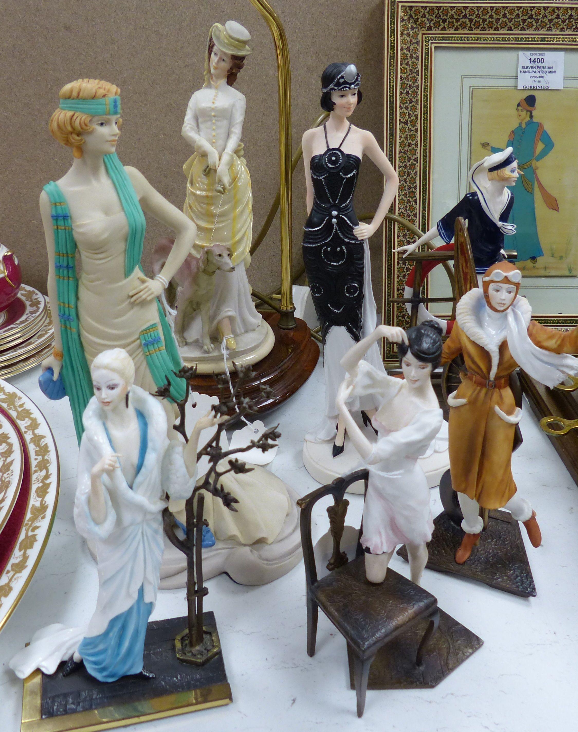 Four Albany bronzed metal and ceramic of elegant 1920's ladies, including 'Female Aviator', three