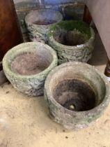 A set of four circular reconstituted stone garden planters, diameter 29cm, height 23cm