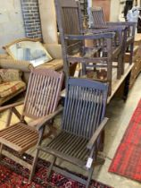 Three various teak folding garden elbow chairs together with two other teak garden chairs