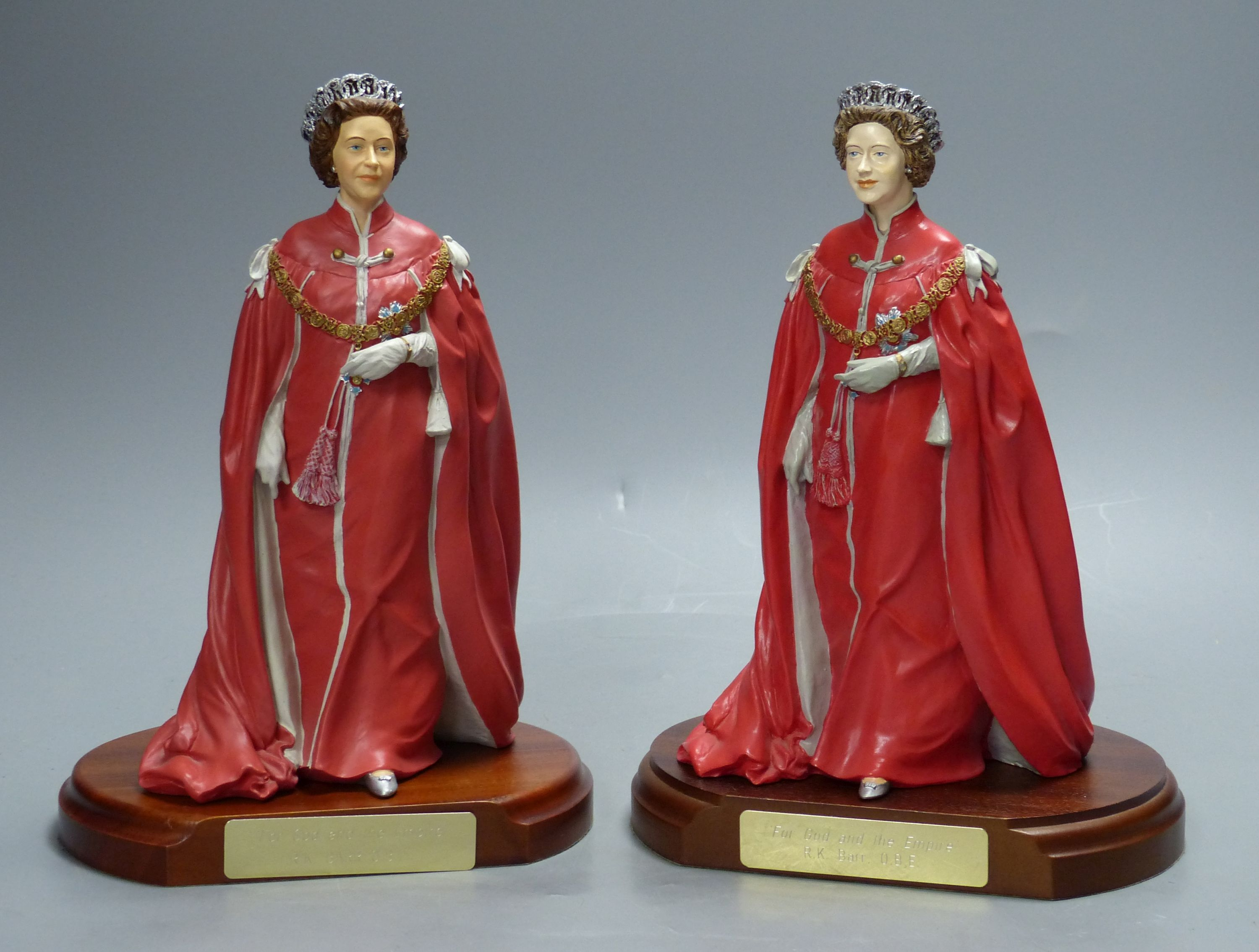 Two cold-cast porcelain figures of HM Queen Elizabeth II by Timothy Potts,commissioned for those