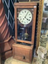 An early 20th century oak cased clocking in clock, height 116cm