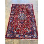 A Tabriz red ground medallion rug, 250 x 153cm