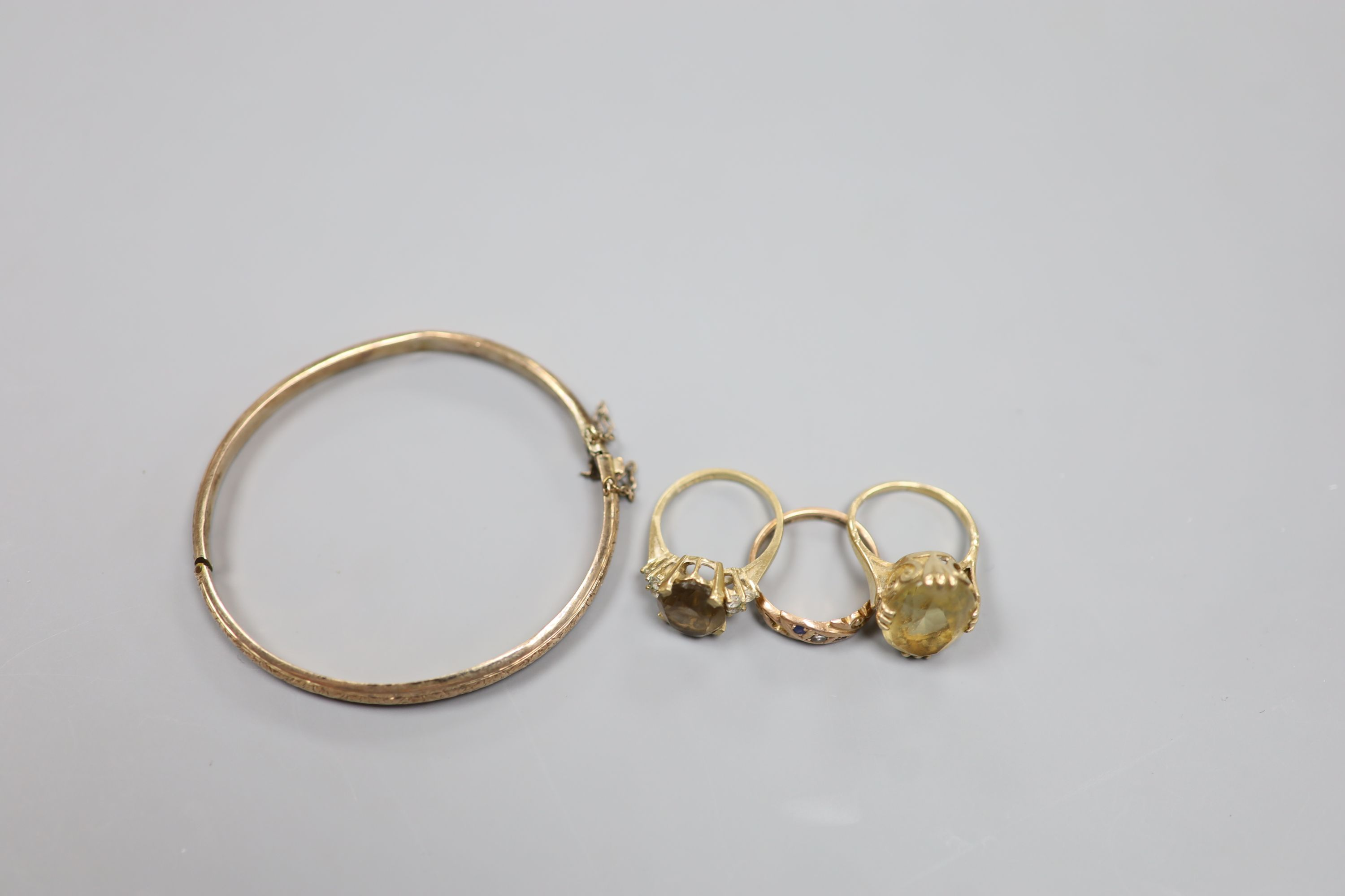Three assorted 9ct and gem set rings and a 9ct gold hinged bangle,gross 18.1 grams. - Image 3 of 3