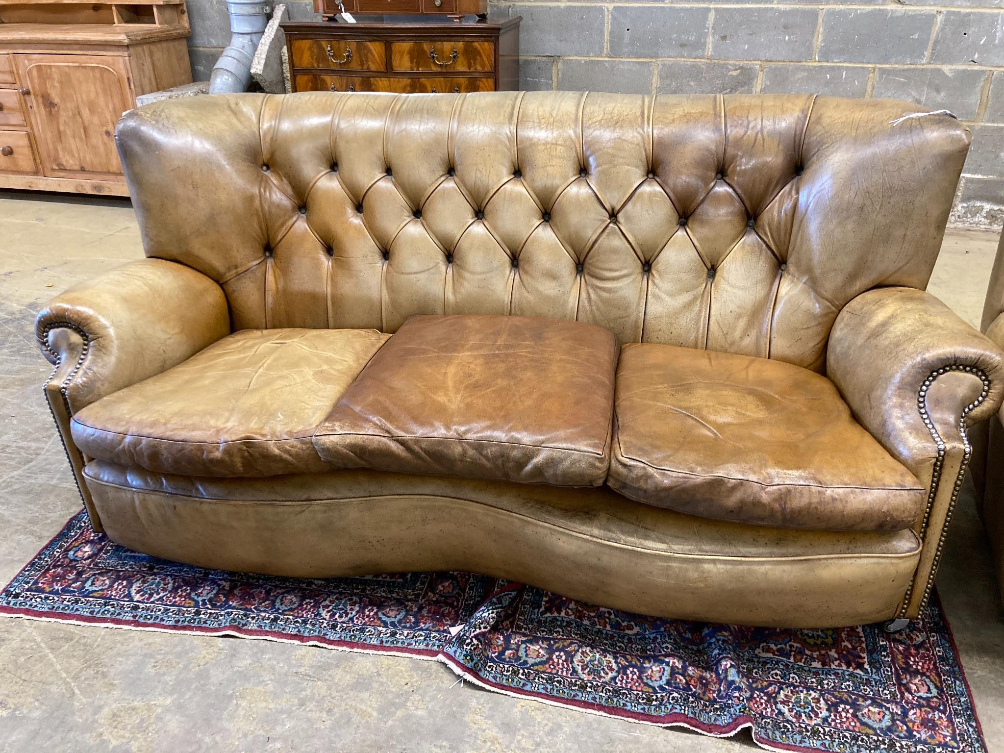 A three-seater Chesterfield leather settee, length 180cm, depth 100cm, height 84cm and a matching - Image 2 of 3