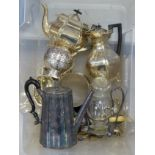 A four-piece silver-plated tea service, a plated ball-shaped string holder, a pair of fish servers
