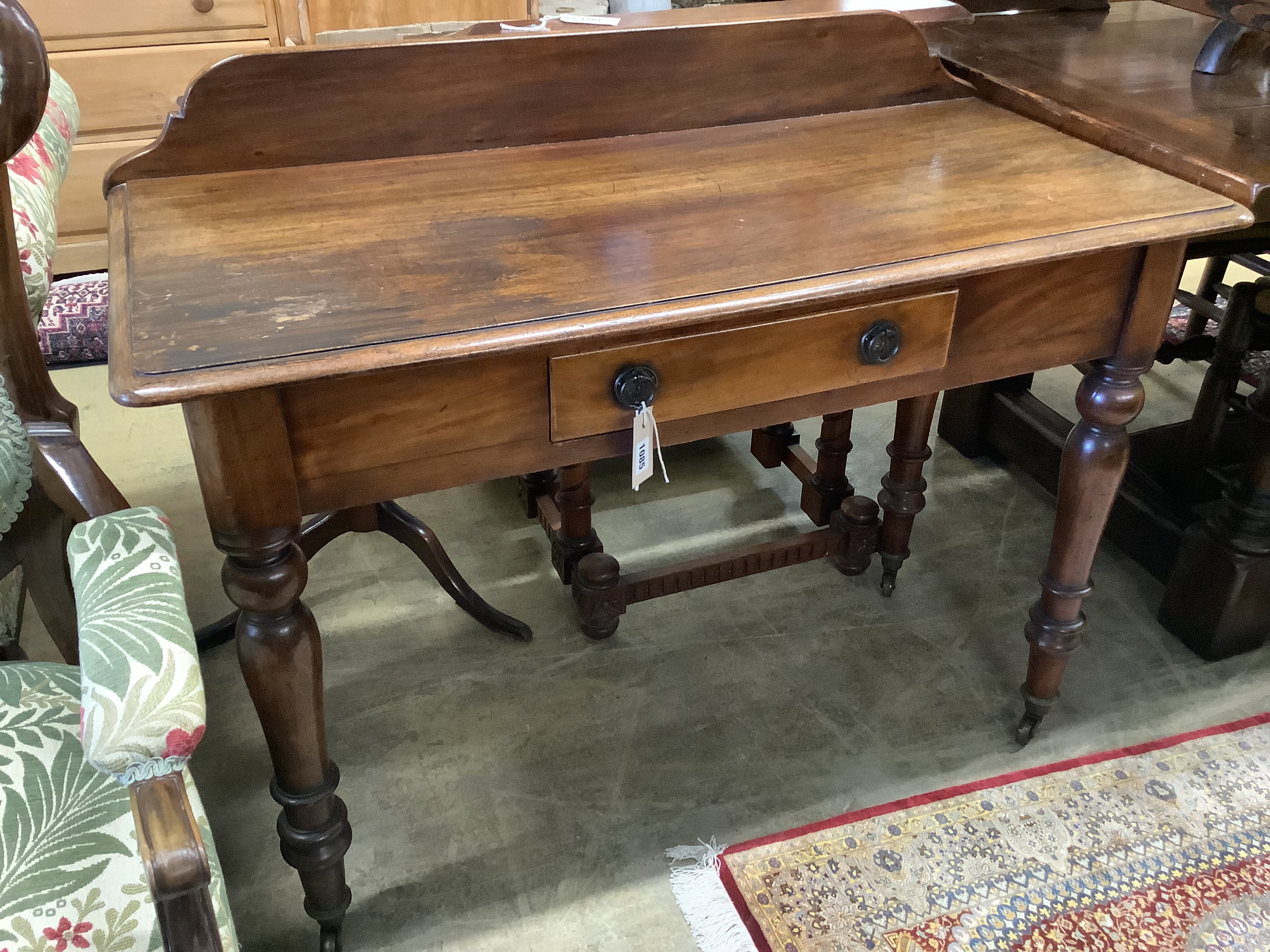 A Victorian mahogany writing tablefitted two small drawers on turned tapered legs, length 106cm, - Image 5 of 6