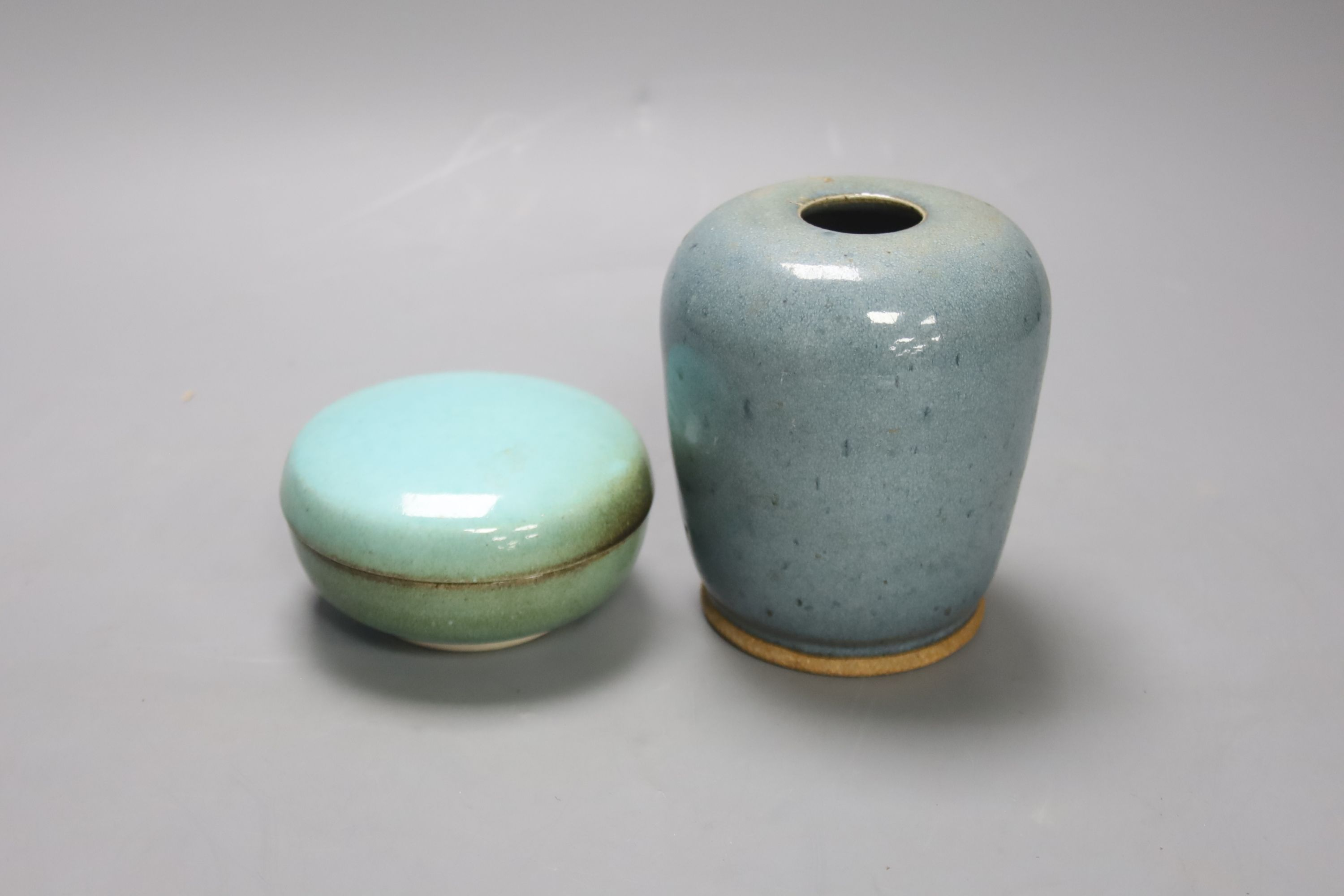 A robin's-egg glazed Studio pottery vase, height 11.5cm, and a box