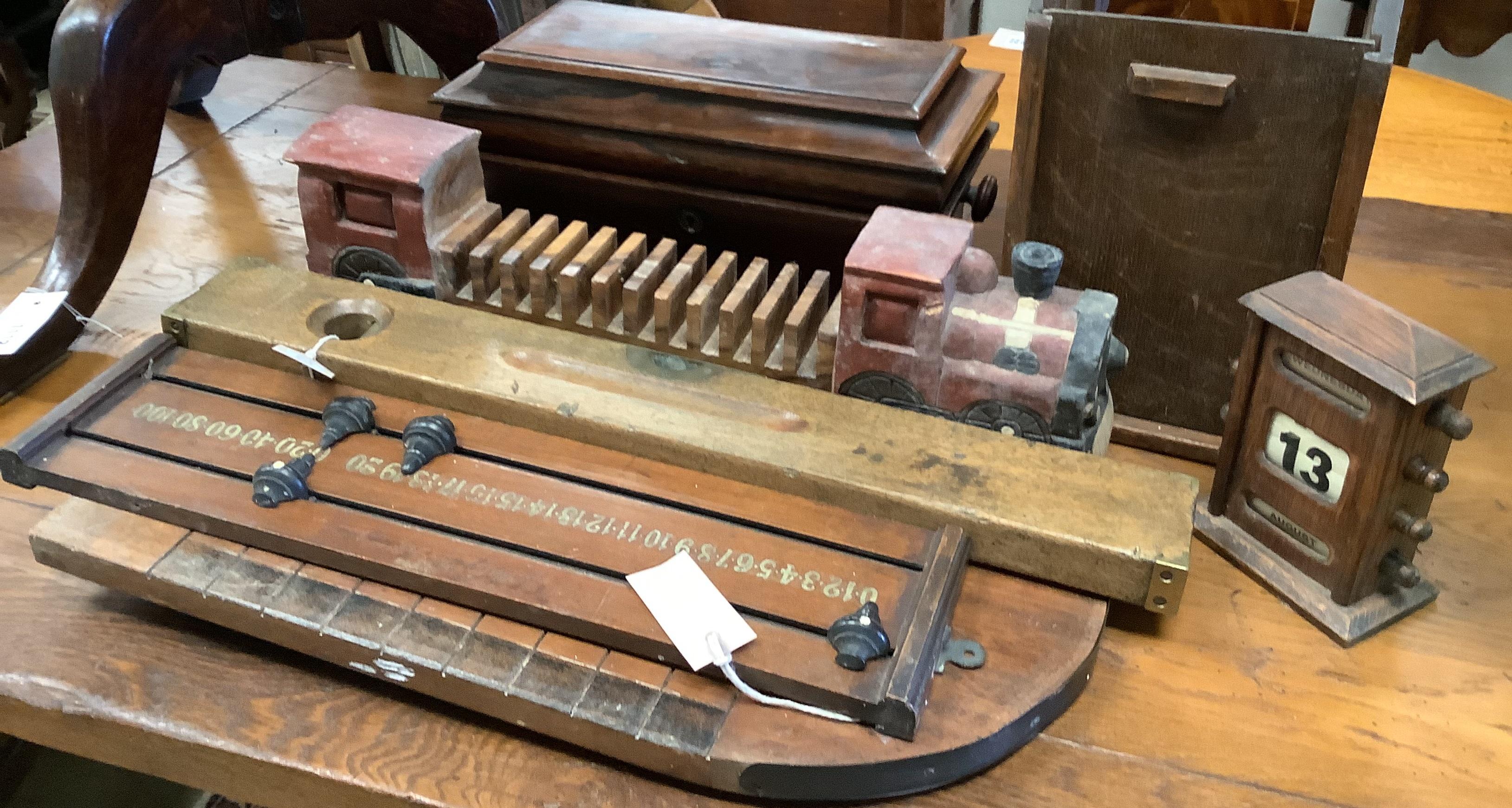 A Shove Ha'penny board, a Preston & Sons brass-mounted spirit level, a Riley's billiards scoreboard