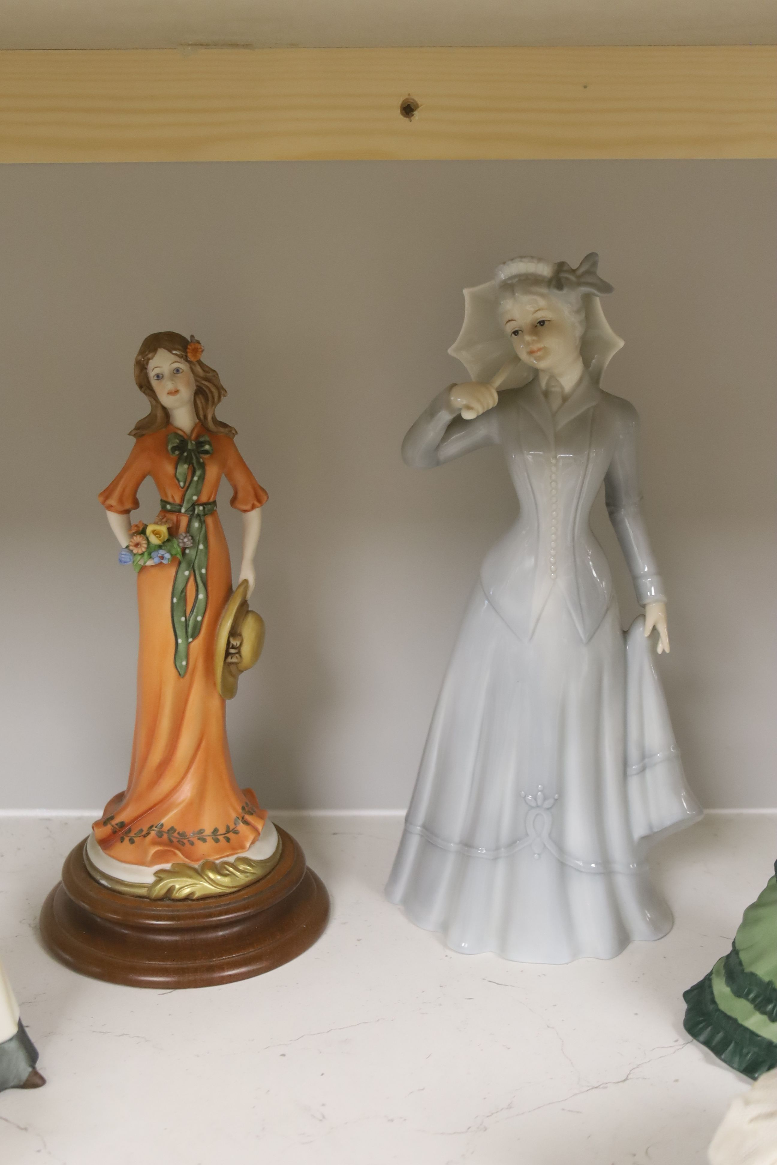 A German porcelain group of two children by a tree stump, on rocky base, two 'crinoline' figures - Image 6 of 6