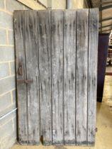 A 19th century oak barn door, width 124cm, height 213cm