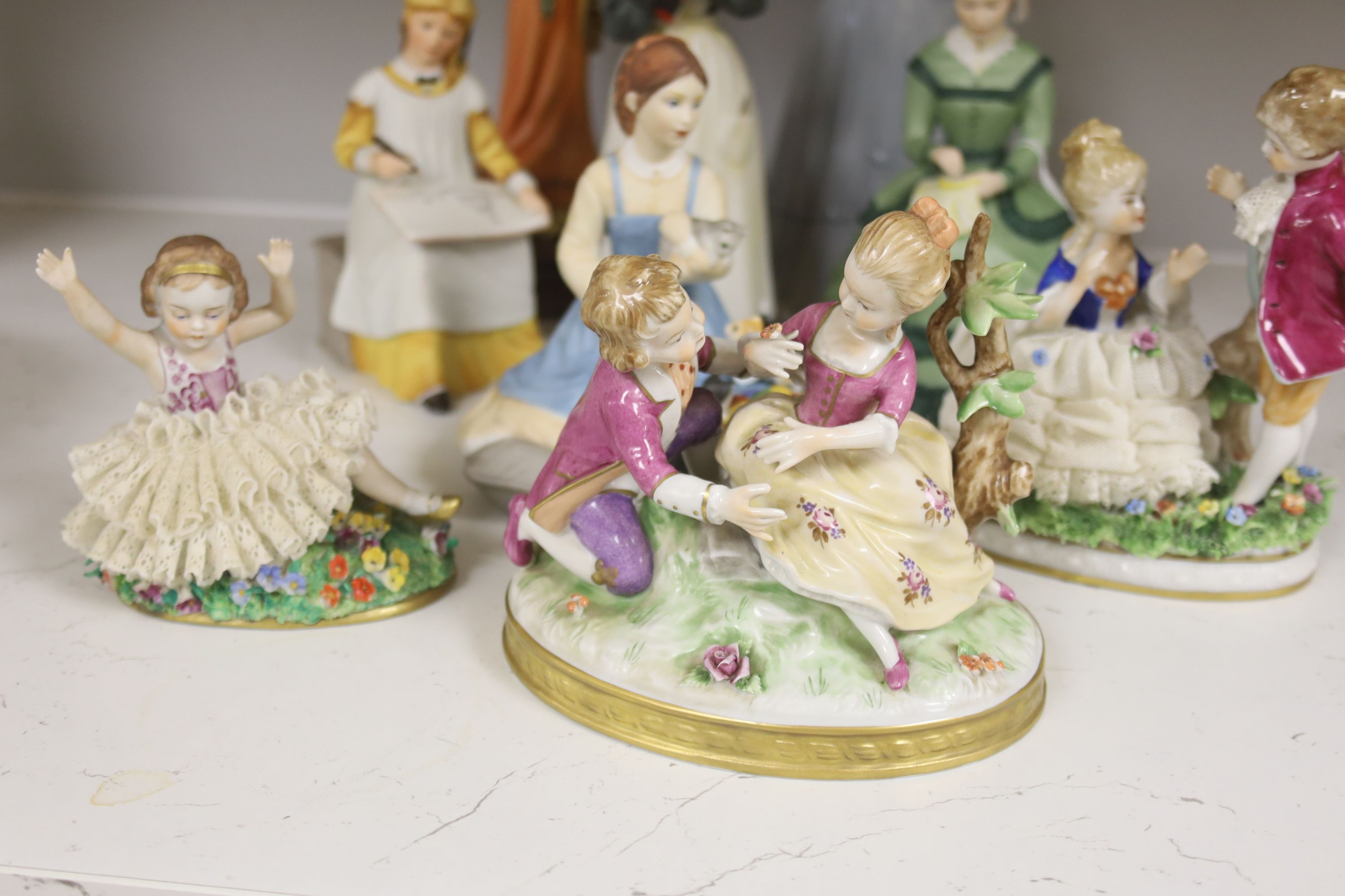 A German porcelain group of two children by a tree stump, on rocky base, two 'crinoline' figures - Image 2 of 6