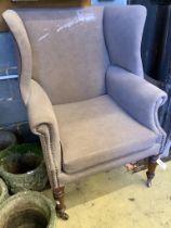 A Regency mahogany wing armchair, width 78cm, depth 70cm, height 97cm