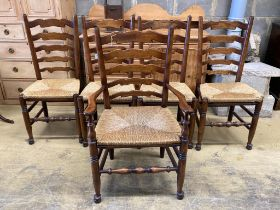 A set of five Lancashire ash and beech rush-seat ladderback chairs (one with arms)