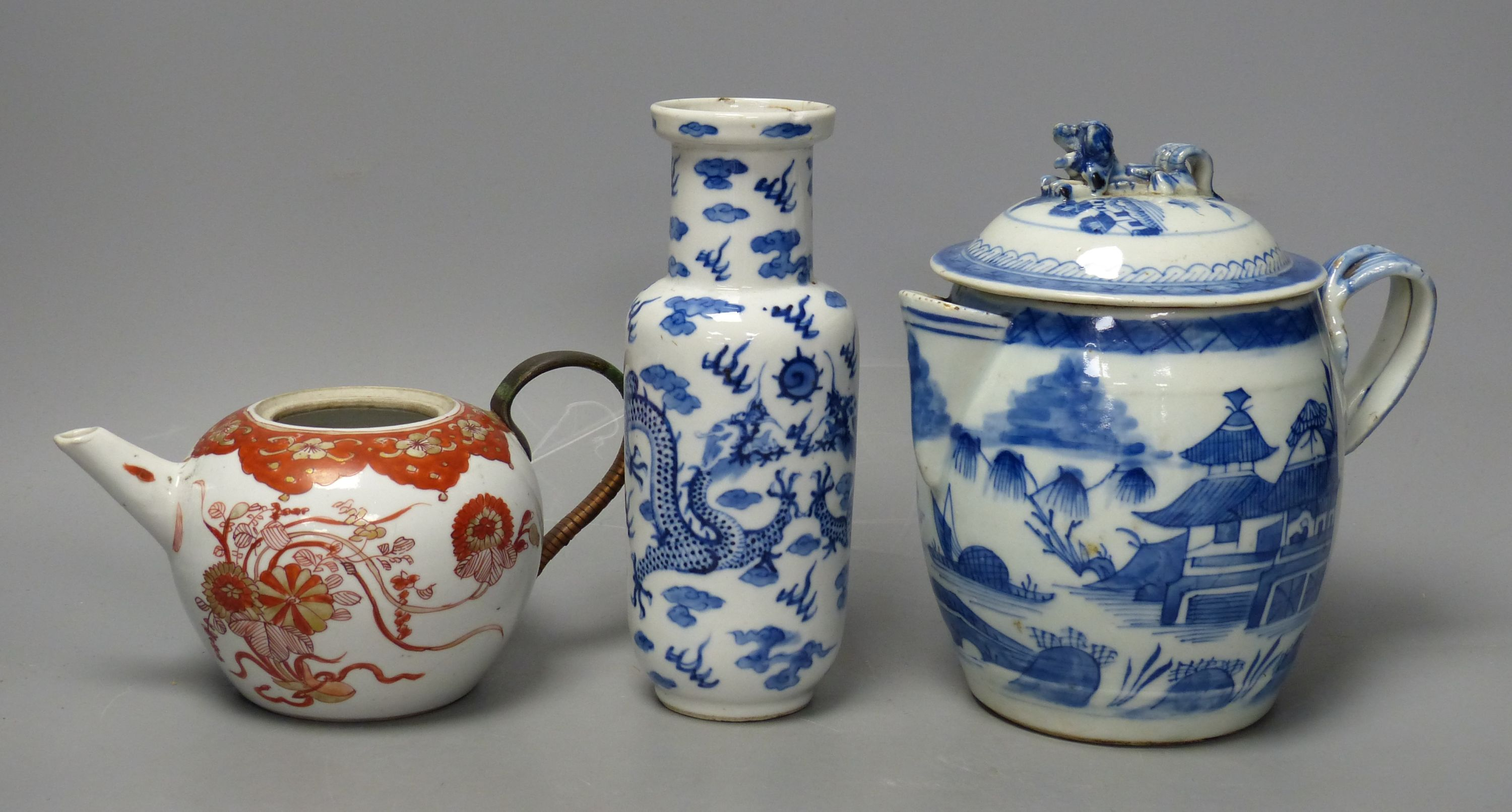 A 19th century Chinese blue and white covered jug, an early 20th century blue and white vase and a