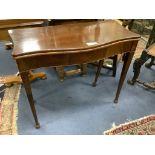 A George III style mahogany serpentine folding card table, width 87cm, depth 44cm, height 74cm