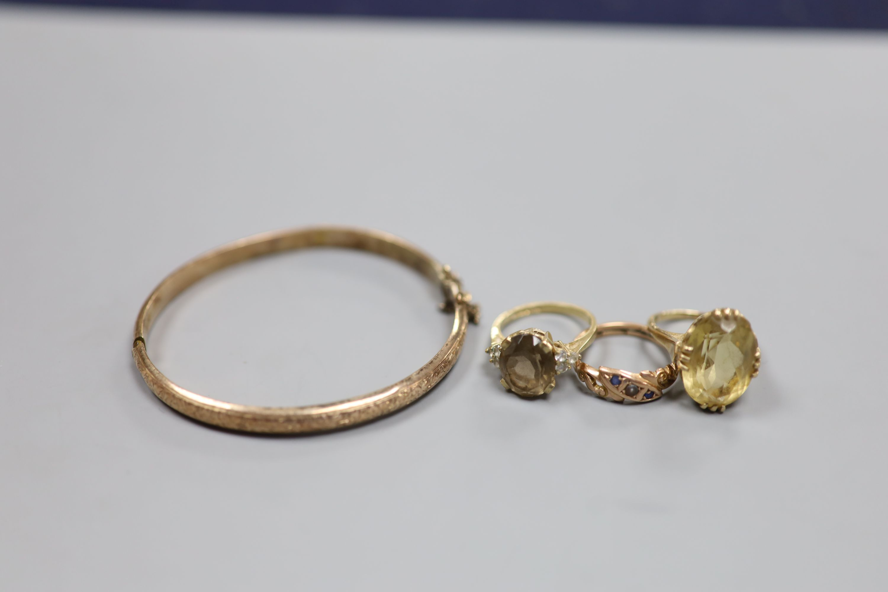 Three assorted 9ct and gem set rings and a 9ct gold hinged bangle,gross 18.1 grams. - Image 2 of 3