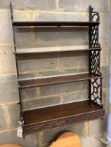 A George III mahogany fret cut four tier wall bracket, width 64cm, depth 22cm, height 94cm