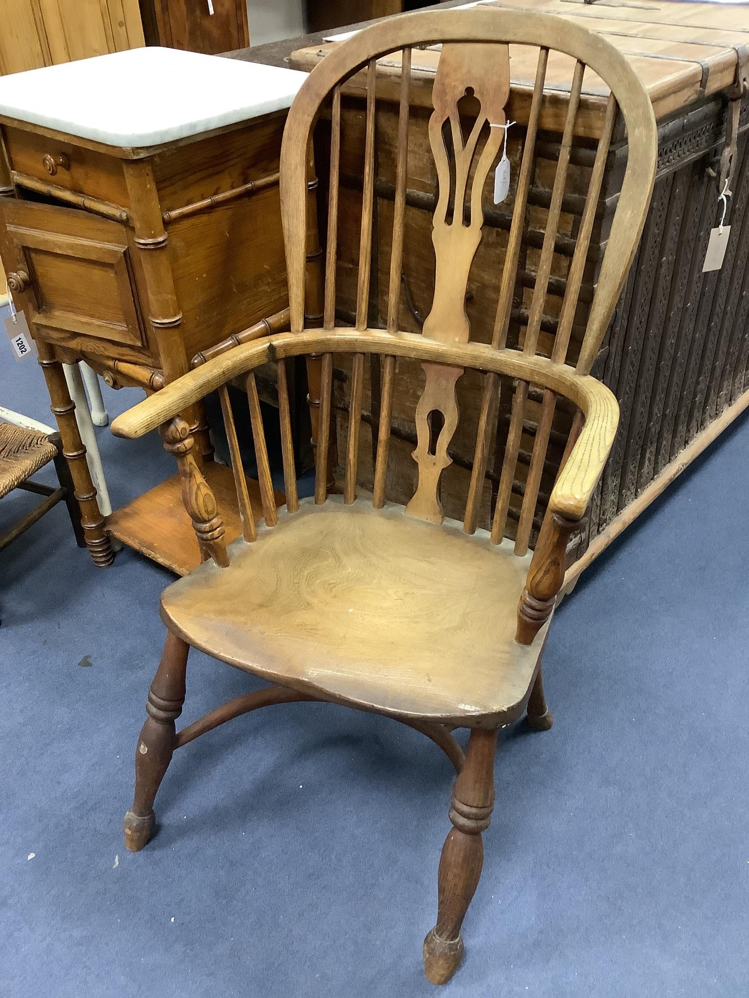A small Victorian ash and elm Windsor elbow chair