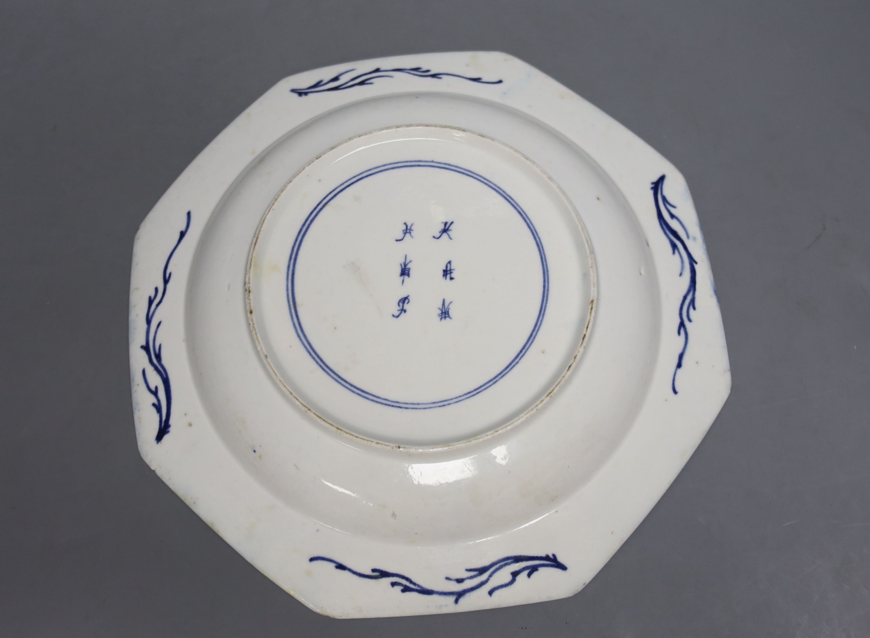 A Bow octagonal plate, painted with landscapes on a blue ground, c.1757, six character mark, 22cm - Image 2 of 2