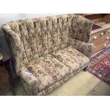 A barrel back upholstered 1920's two seat sofa, length 140cm, depth 70cm, height 110cm