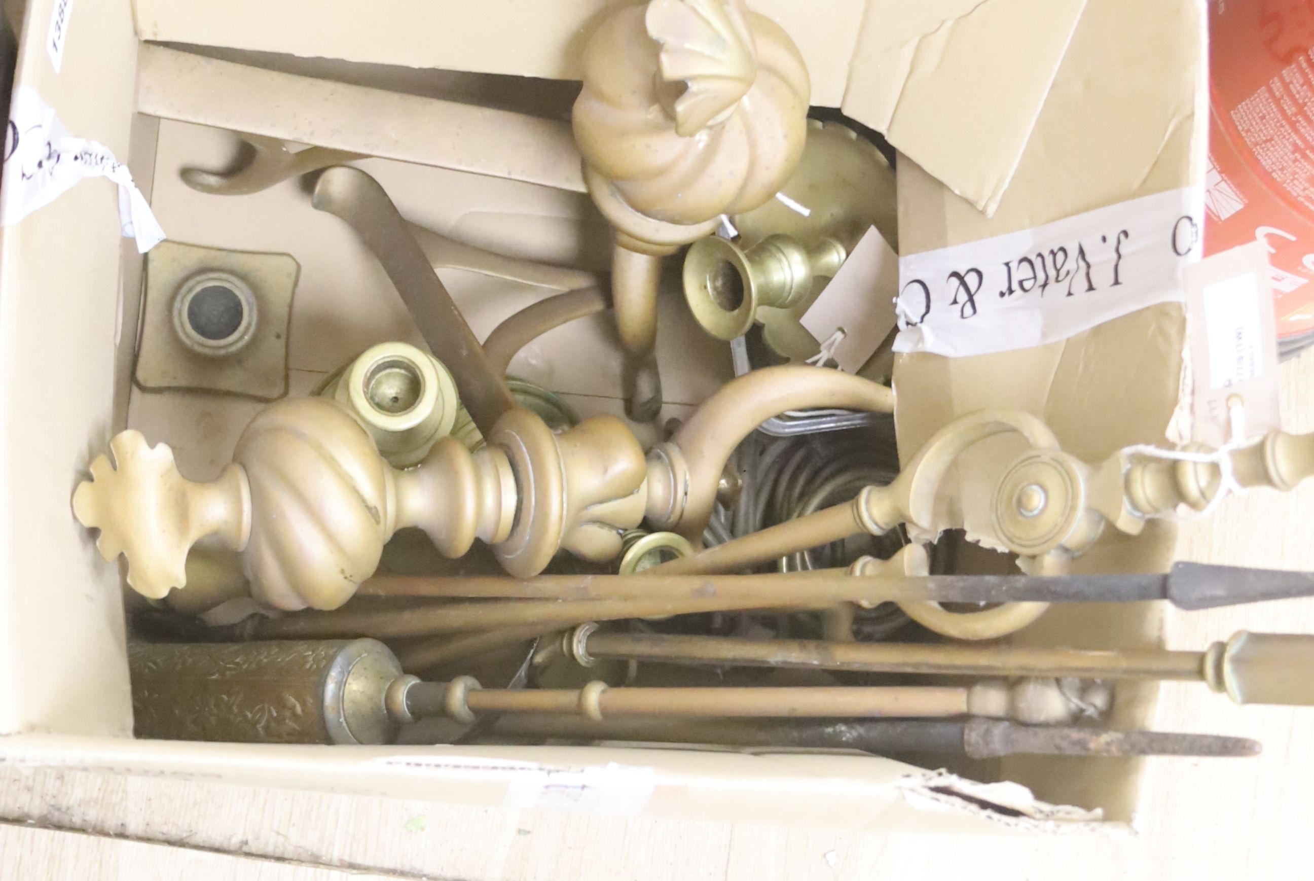 Sundry metalware, including a pair of fire dogs, various fire implements, brass chambersticks and