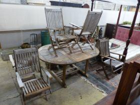 A 'Westminster' extending teak garden table, length 171cm and a set of six folding chairs
