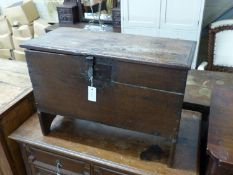 A 17th century oak six plank coffer with candle box (top a.f.), width 73cm