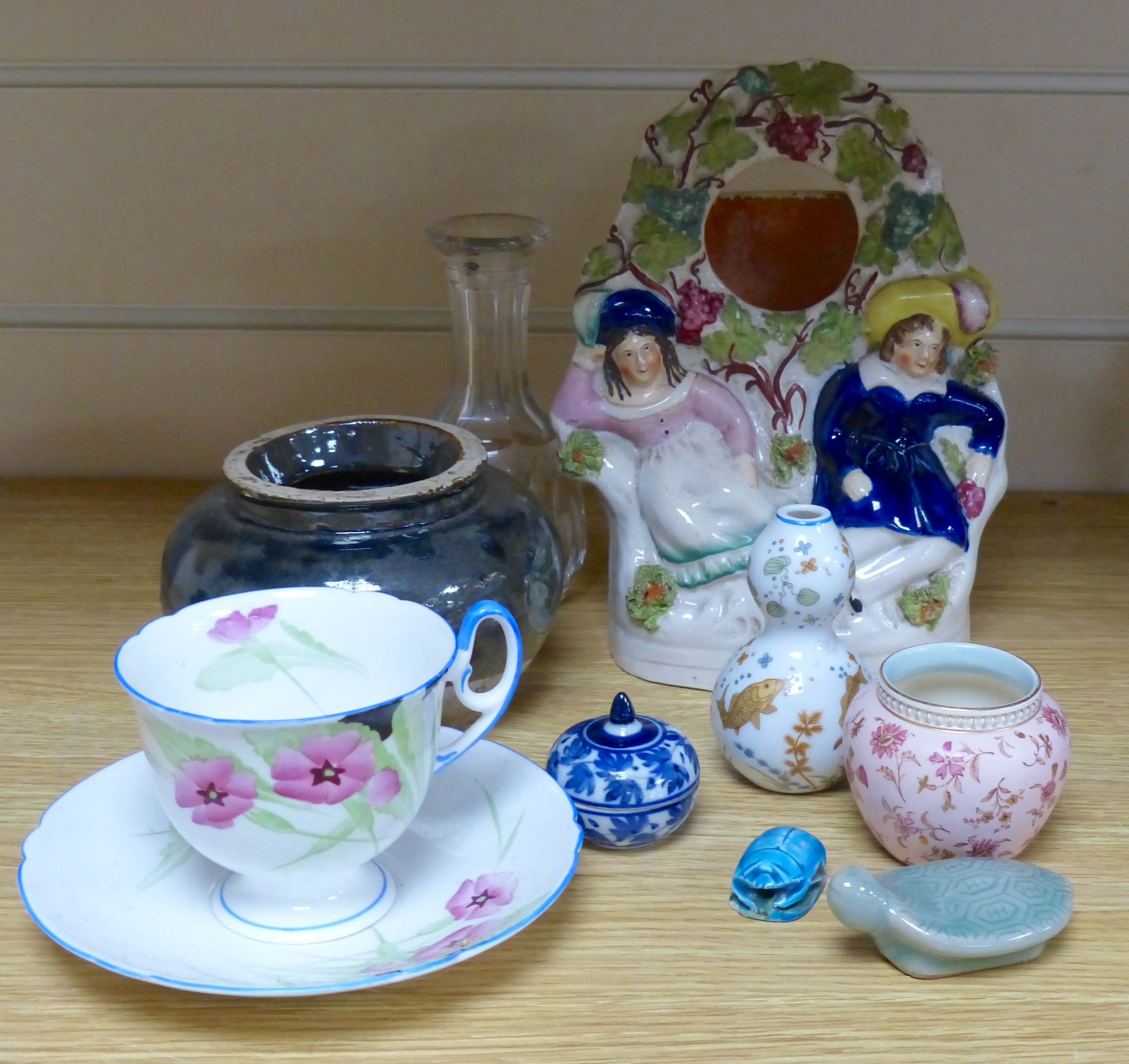 A group of ceramics including a Shelley cup and saucer, a Staffordshire flatback, a Wedgwood