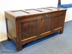 A William III oak coffer, dated 1695, 124 cm wide, 60 cm high, 46.5 cm deepProvenance - a country