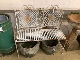 A wrought iron folding garden bench, length 103cm