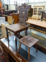 A late Victorian carved oak hall chair and a small occasional table