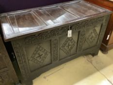 A late 17th / early 18th century carved panelled oak coffer, width 110cm depth 55cm height 65cm