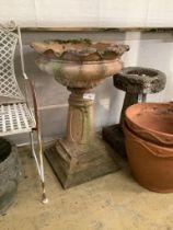 A reconstituted stone pedestal garden urn, height 83cm