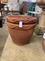 A pair of circular terracotta garden planters, diameter 51cm