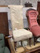 A Victorian mahogany framed prie dieu chair, upholstered in cream brocade
