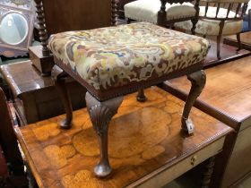 A Queen Anne style carved walnut stoolwith tapestry upholstery, length 56cm, width 46cm, height