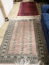 A Bokhara style rug, 166 x 97cm and another pale pink ground rug