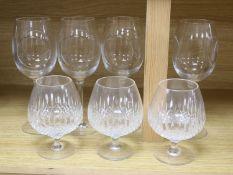 Four John Rocha Waterford wine glasses and three Stuart cut glass brandy glasses
