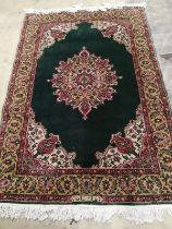 A Romanian green ground rug, 183 x 124cm
