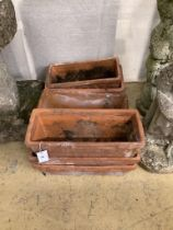 A set of three terracotta garden troughs and four similar troughs, approx. 40cm, wide