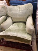 A George Smith Howard style armchair upholstered in pale green velvet, width 80cm, depth 110cm,