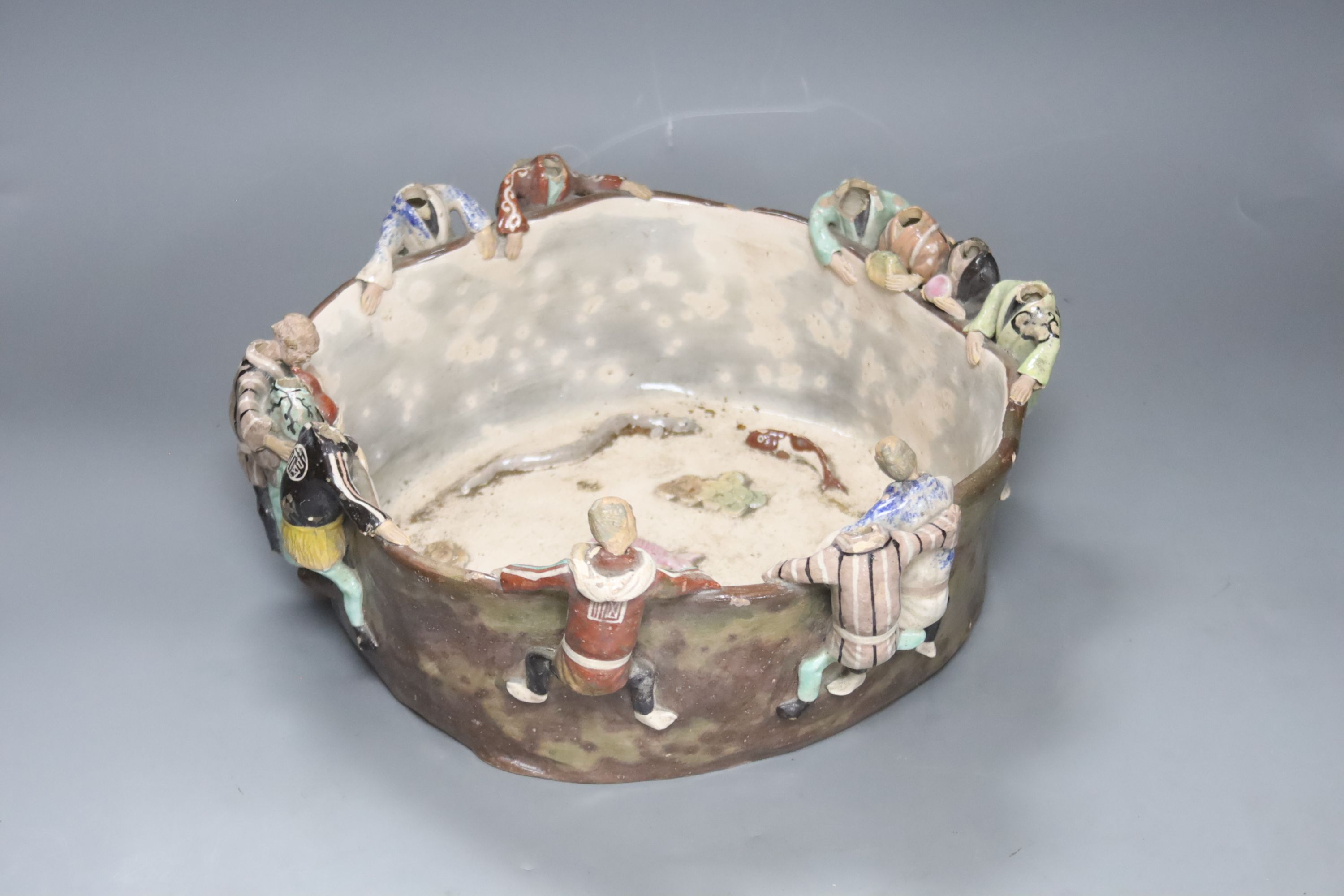 An unusual Japanese Sumida style pottery bowl, figures with detaching heads, diameter 32cm