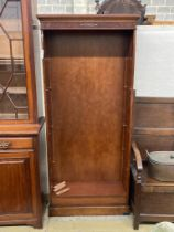 A reproduction mahogany open fronted bookcase, length 82cm, depth 28cm, height 183cm
