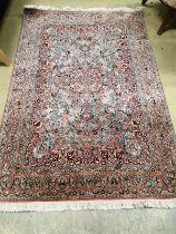 A Kashan style part silk blue ground rug, 185 x 123cm