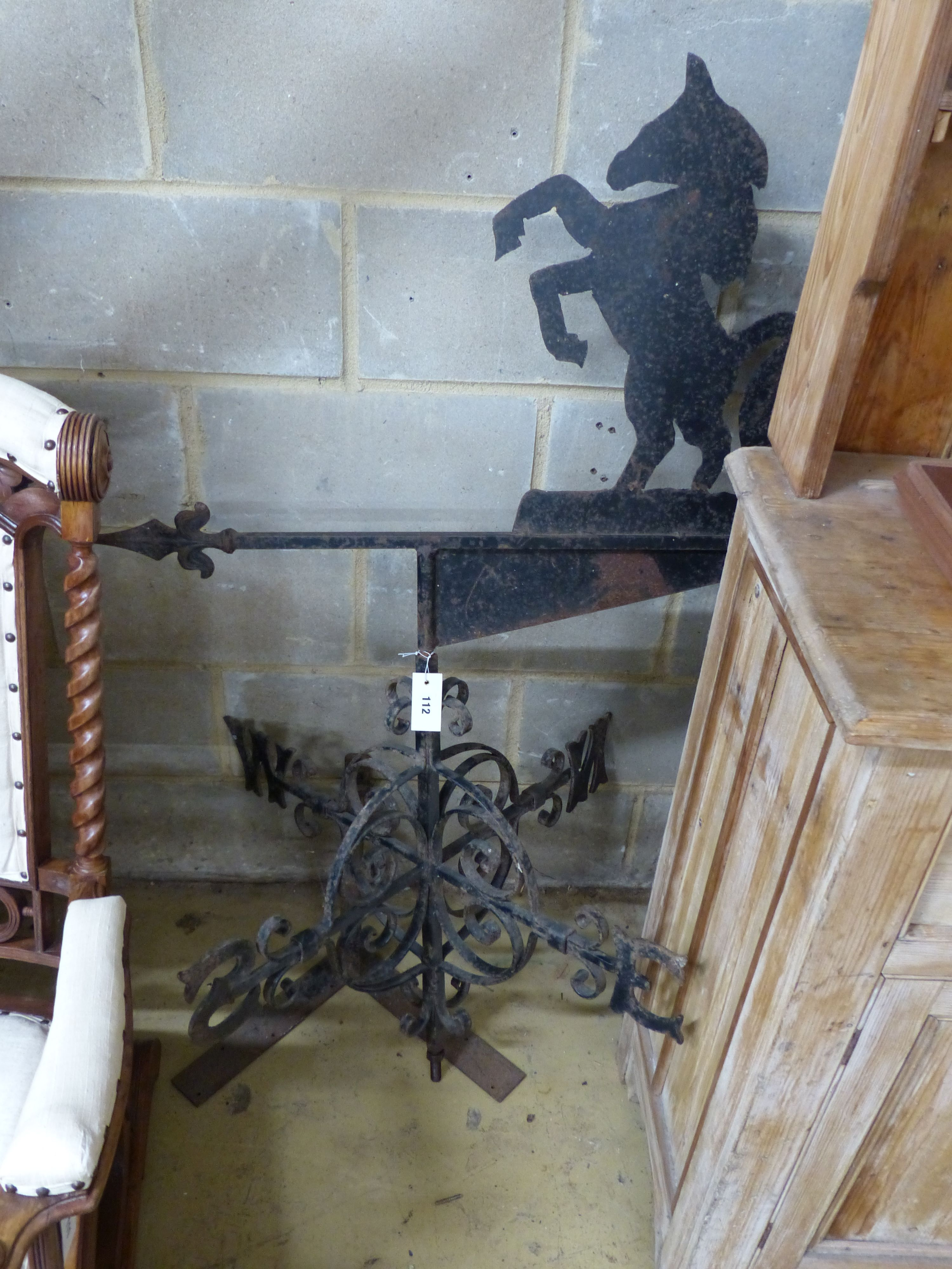 A wrought iron weather vane with rampant horse finial, height 137cm